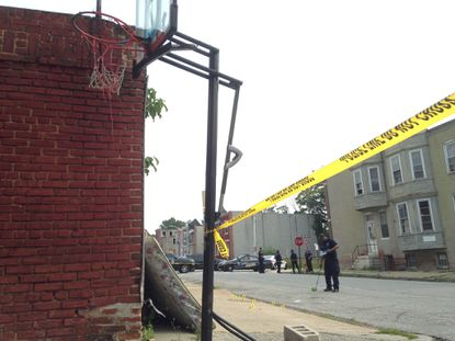 Homicide detectives and crime scene technicians find bullet casings on a blood-stained sidewalk in East Baltimore Midway, where a man was shot in the head, police said. It was the second shooting on the city's east side Sunday, after a 23-year-old was shot in Madison-Eastend in the morning.