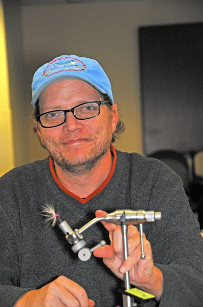 """""""Laughing again..."""" Daniel Cowrey admires the Tenkara fly he just tied at a Project Healing waters Fly Fishing session at Fort Meade."""