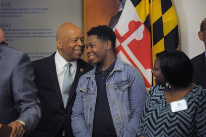 United States Congressman Elijah E. Cummings (D-7th, Md.) and Douglass High School student Maurice Glenn, 15 chat during a press conference at Frederick Douglass High School after state and national officials met with students.