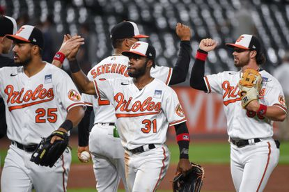 Baltimore Orioles center fielder Cedric Mullins (31) and high fives teammates after the 6-3 win.
