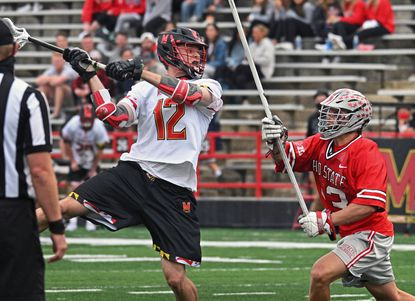 Maryland's Logan Wisnauskas, left, shoots against Ohio State's George Walsh in the third quarter.