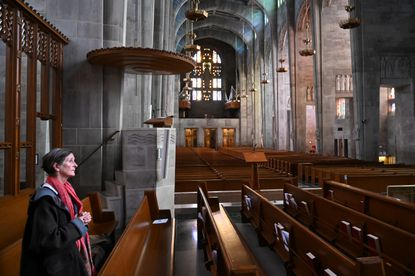 """Elizabeth Lombardi of Baltimore realized the Mass at the Cathedral of Mary Our Queen might be closed, but she found a way in to pray for """"all the countries of the world."""" The Archdiocese of Baltimore decided to close churches due to the coronavirus threat."""