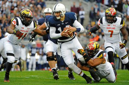 Penn State quarterback Christian Hackenberg is brought down by Maryland defensive end Andre Monroe during the first quarter for a sack at Beaver Stadium.