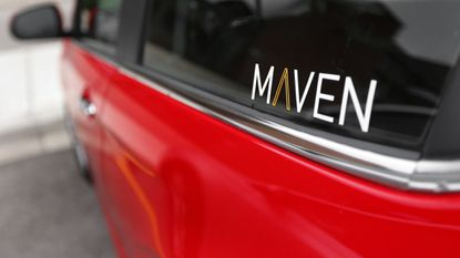 This April 27, 2016, file photo, shows the Maven logo on a General Motors car-sharing service automobile, in Ann Arbor, Mich. General Motors is retreating from eight of the 17 North American markets where it had started a car-sharing service called Maven.