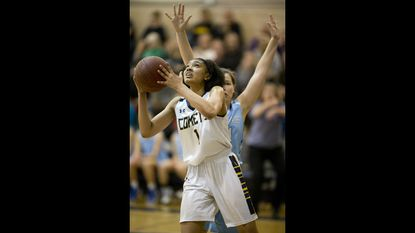 Catonsville's Jameila Barrett, shown shooting in front of Mount de Sales' Maura Devine in the Comets win over the Sailors early this season, scored 39 points against Randallstown in the Comets' 75-26 win on Jan. 31 and reached the 1,000-point scoring mark.