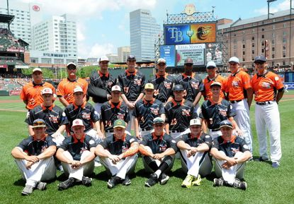 Members of the South team in the Brooks Robinson High School All Star game — including Glenelg's Garrett Southern, Mt. Hebron's Mark Smith, Reservoir's Cody Morris and Jack Barry, Wilde Lake's Cuinn Mullins and Reservoir coach Adam Leader — pose for a photo before the Orioles game against Tampa Bay on May 31.