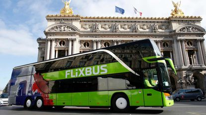 This 2015 file photo depicts a bus of the German intercity service FlixBus driving past the Palais Garnier opera house in Paris.