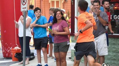 Spectators cheer runners as they finish the race during the Coolest Mile on Main Street in downtown Sykesville in 2017. This year's event is set for Sunday, July 1.
