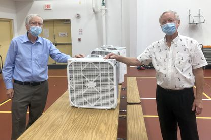 David Wells, left, and his brother, John Wells, right, held a demonstration Thuraday at Pip Moyer Recreation Center about how their homemade air filtration device might work during the upcoming November election.