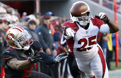 San Francisco 49ers wide receiver Quinton Patton (11) cannot catch a pass in front of Arizona Cardinals cornerback Jerraud Powers (25) during the first half in Santa Clara, Calif., Sunday, Nov. 29, 2015.