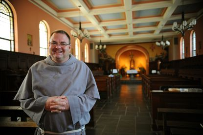 Fr. Michael Heine is pictured in the chapel of the Shrine of St. Anthony.
