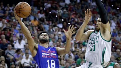 The 76ers' Melo Trimble shoots around the Celtics' Jayson Tatum during the first half of an NBA summer league game on Tuesday, July 11, 2017, in Las Vegas.