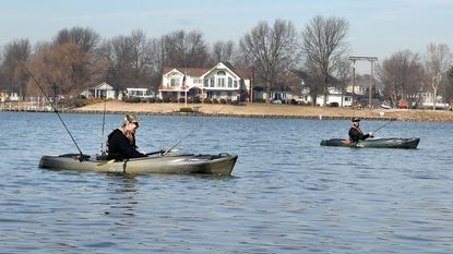 Friends Dave Beauchamp, left, and Sam Smith set out in their kayaks at Mariner Point Park in Joppatowne.