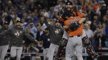 Houston Astros catcher Brian McCann leaps into the arms of pitcher Charlie Morton after Game 7 of the World Series against the Dodgers on Nov. 1 in Los Angeles. Houston prevailed, 5-1, to win the championship.