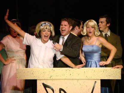 The lively new production of the Broadway musical ¿Hairspray¿ at Cockpit in Court Summer Theatre is another opportunity to consider the deep local roots of this show ¿ and to ponder your preference for it in one medium or another.