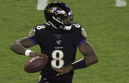 The Ravens' Lamar Jackson grips the ball before launching a pass during a game against the New York Jets on Thursday night.
