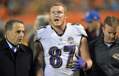Ravens tight end Maxx Williams (87) is helped to the locker room in the second half against the Cleveland Browns, Monday, Nov. 30, 2015, in Cleveland.
