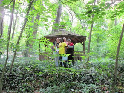 """Students gather at a gazebo in the """"backwoods"""" of Roland Park Country School, which is installing a stormwater management system to deal with erosion."""