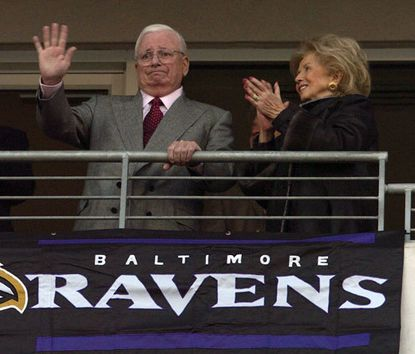 Then-owner Art Modell acknowledges the crowd after his name is added to the Ravens Ring of Honor Jan. 3, 2004. His wife, Patricia Modell, is at his side.