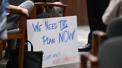 Community members attend Monday's Howard County Council meeting to support a plan to remove 19 buildings from Main Street in Ellicott City. A historic preservation advisory commission is studying the plan.