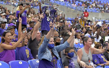 Fans cheer the Baltimore Ravens' team practice in front of spectators at the stadium Sat., July 31, 2021.