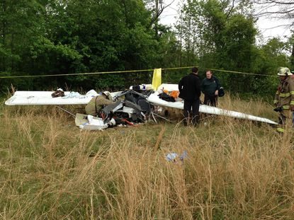 Authorities investigate the scene of a plane crash in Suffolk, Va., that killed Berry Raymond Newgent, 73, of Davidsonville and Thomas Berry Newgent, 51, of Westminster.