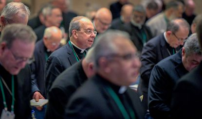 Clergy sex abuse is once again on the agenda as U.S. Catholic bishops meet this week — but so is a potentially historic milestone: Los Angeles Archbishop Jose Gomez, an immigrant from Mexico, is widely expected to win election as the first Hispanic president of the bishops' national conference. William Lori, archbishop of Baltimore, stands Monday for during the opening prayer at the Baltimore Marriott Waterfront.