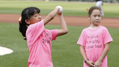 Sara Hinesley, 10, of Frederick, threw out the ceremonial first pitch before the Friday, June 28 game between the Orioles and Cleveland Indians.