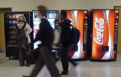 Four of five Howard County Council members, all Democrats, voted on Friday to overturn County Executive Allan Kittleman's veto of a bill that creates nutritional guidelines for the food and drinks sold in government vending machines.