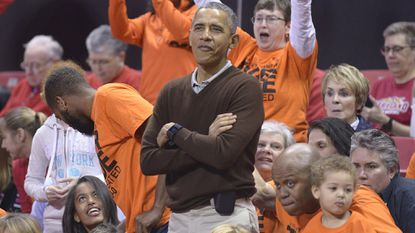 Then-President Barack Obama attends the Princeton-Green Bay game in the NCAA women's college tournament three years ago in College Park.