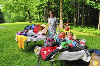 Hereford High rising senior Robbie Palmisano shows some of the gently used sports equipment he has collected. Palmisano does needed cleaning and repairs and donates the items to Baltimore recreation councils.