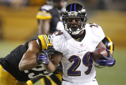 Ravens running back Justin Forsett runs after a pass reception against the Pittsburgh Steelers during the second quarter at Heinz Field.