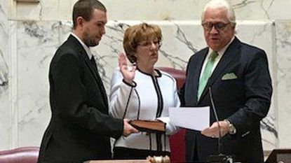 Linda Norman is sworn in by Maryland Senate President Thomas V. Mike Miller, right, last Friday. Her son, H. 'Chip' Wayne Norman III, holds the Bible. Gov. Larry Hogan appointed her to fill the term of her late husband, Sen. H. Wayne Norman Jr., who died March 4.