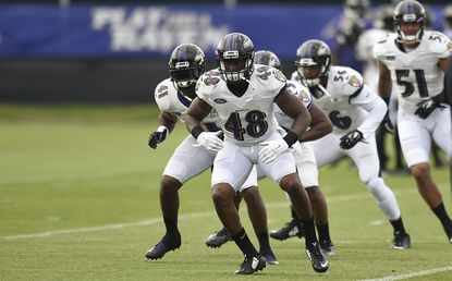 Ravens rookie Patrick Onwuasor, front, leads linebackers in a drill during practice at training camp, Saturday, July 30, 2016.