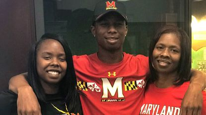Terps basketball player Serrel Smith Jr. is pictured with his mother, Tamika Coley, right, and sister, Kamika Idon, left, after signing with Maryland on April 11 in College Park.
