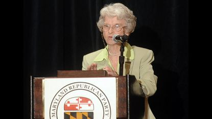 The late Marjorie Holt introduces Newt Gingrich at the 21st annual Red, White and Blue dinner in Linthicum in 2011.