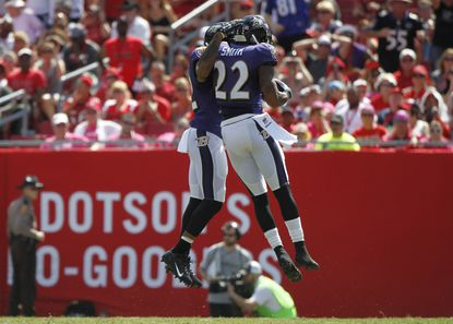 Baltimore Ravens cornerback Jimmy Smith (22) celebrates after intercepting the ball against the Tampa Bay Buccaneers during the first quarter at Raymond James Stadium.