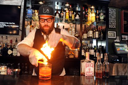 Bar Liquorice's Shaun Stewart uses fire while making an Old Fashioned on a recent Saturday night.