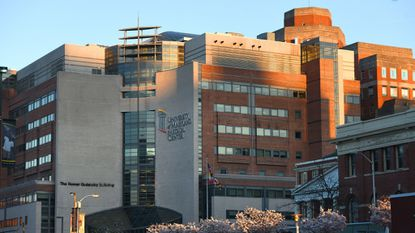 The University of Maryland Medical Center in Baltimore dropped a plan Wednesday to seek more revenue from patients, a request critics called ill-timed in light of allegations of improper spending and above-average profits by the 13-hospital University of Maryland Medical System.