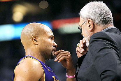 Point guard Derek Fisher and Coach Phil Jackson discuss strategy during Game 1 of the NBA Finals in 2008, which marked the return of the Lakers to championship-level basketball.