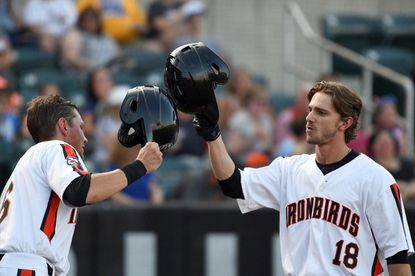 IronBirds' Zach Watson, right, shown celebrating a home run with teammate Toby Welk in 2019, hit an RBI triple in Wednesday's 4-2 Aberdeen win over Wilmington.
