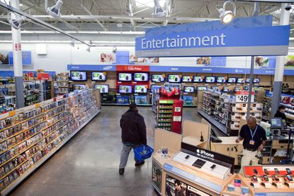 Walmart is taking down all signs and displays from its stores that depict violence, following a mass shooting at its El Paso location. It says it has no plans stop selling guns or ammunition.