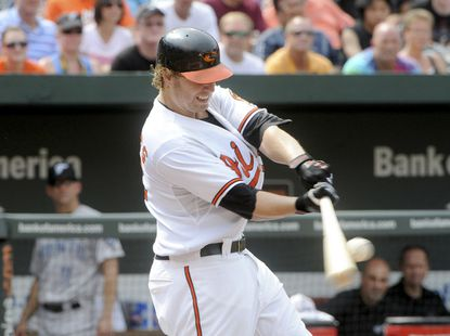 Mark Reynolds hits his second home run of the day against the Blue Jays. Despite the first baseman's big day at the plate, the O's suffered a 7-2 loss to Toronto.