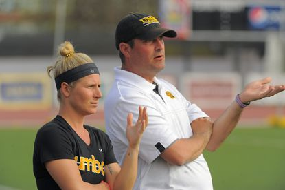 UMBC has named co-coach Amy Slade (left) as the Retrievers' head coach. Tony Giro (right) is on leave from the university.