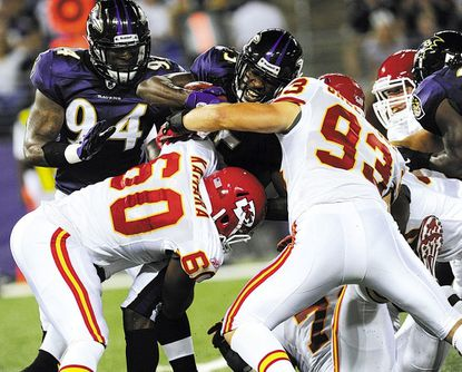 LaQuan Williams is tackled during a punt return in the second half of the Ravens' preseason home opener against the Kansas City Chiefs at M&T Bank Stadium in Baltimore Aug. 19, 2011.