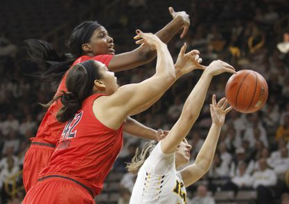Maryland's Brianna Fraser (34) and Brionna Jones (42) compete for a rebound with Iowa's Kathleen Doyle (22) during the second half Saturday, Jan. 14, 2017, in Iowa City, Iowa.