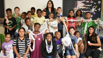 Mara Cho's third-grade class shows the sleeping mat they are creating for the homeless at Hebron-Harmans Elementary School in Hanover.