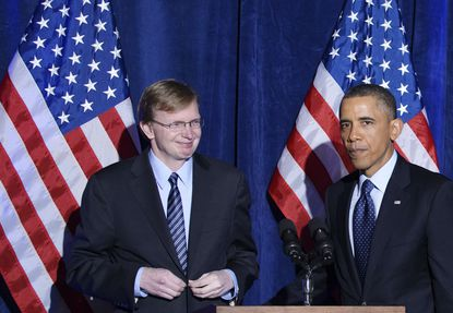 President Barack Obama with Jim Messina, the manager of Obama's 2012 re-election campaign.