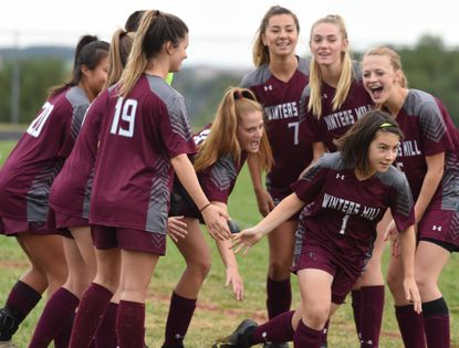 Winters Mill's Kiyomi Mastro (1) is cheered on by her teammates as she's introduced before a girls soccer game against Westminster at Winters Mill High School on Saturday, October 12.