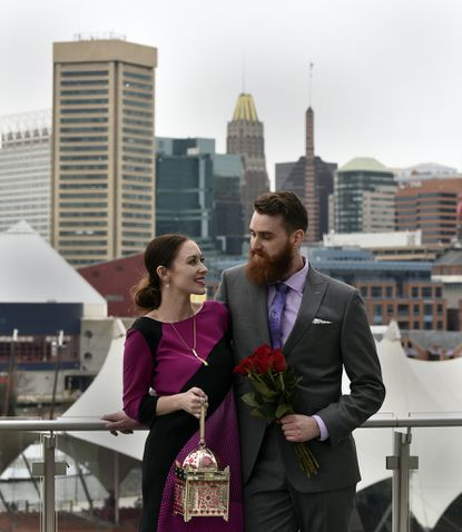 Ashley Ryan and Paul Hutson at the Four Seasons Hotel, a popular spot for proposals and weddings in Baltimore.